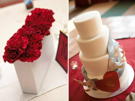 Red carnations packed tightly in white modern vases for reception table centerpieces; classic ivory