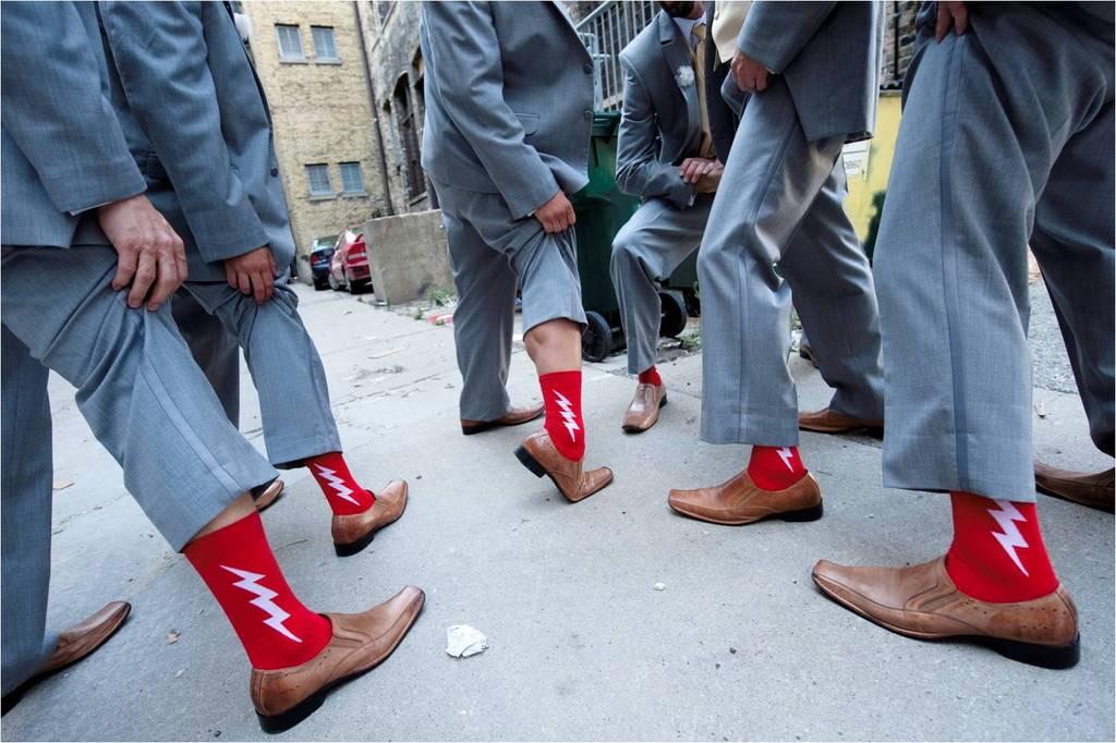 Groomsmen-wear-grey-suits-brown-shoes-red-funky-socks.full