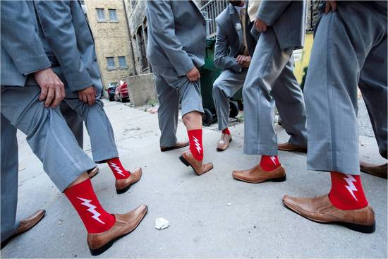 Groomsmen wear grey suits, show off funky red socks