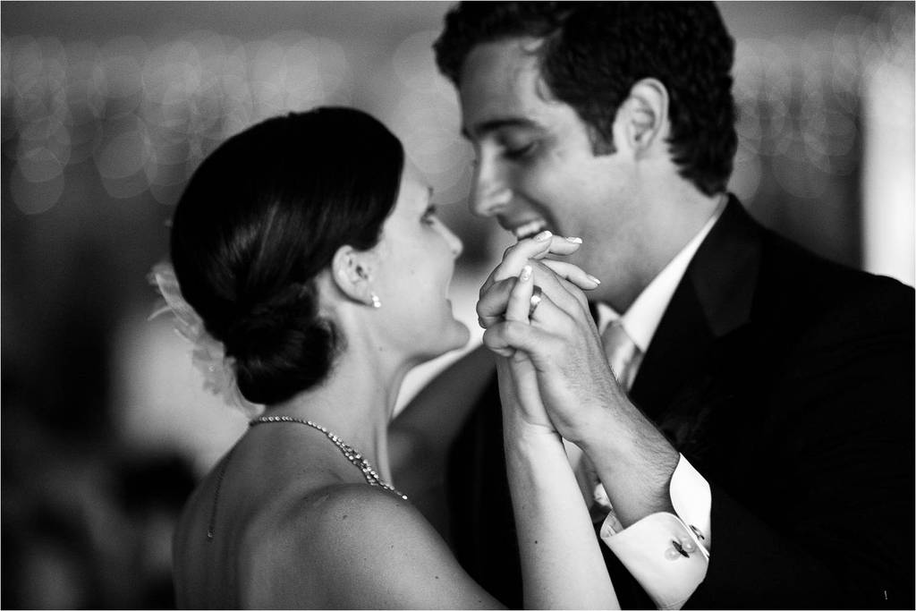 Bride-and-groom-enjoy-first-dance-as-husband-and-wife-black-and-white-wedding-photo.full