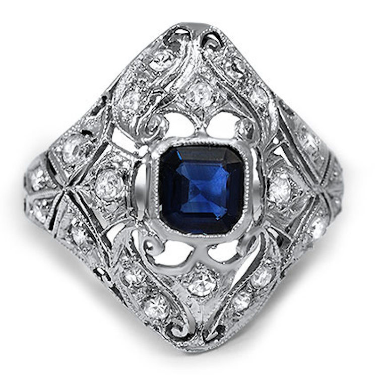 Emerald_cut_sapphire_surrounded_by_diamonds.full