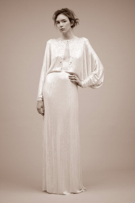 Long sleeved silk sheath wedding dress with slit keyhole on bodice by Jenny Packham