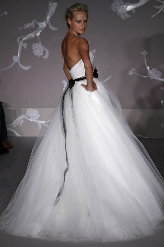 Gorgeous white ball gown wedding dress with tulle skirt and black ribbon sash
