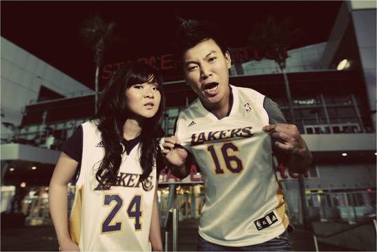 California bride and groom wear LA Lakers jerseys, take e-session photos at Staples Center