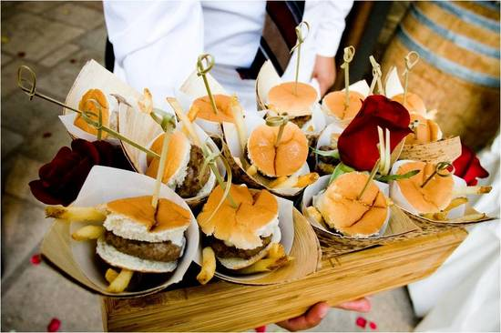 Butler passed appetizers at wedding reception- chic mini burgers