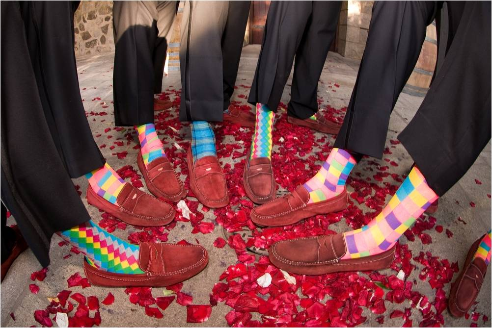Groom-best-man-groomsmen-show-off-red-suede-shoes-and-colorful-striped-socks.original