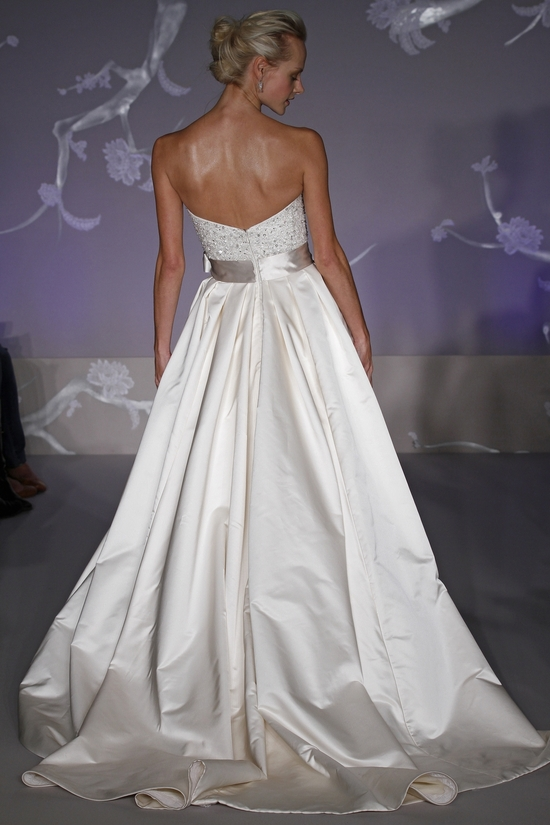 Classic ivory ballgown wedding dress with sweetheart neckline, pockets, and sash- back