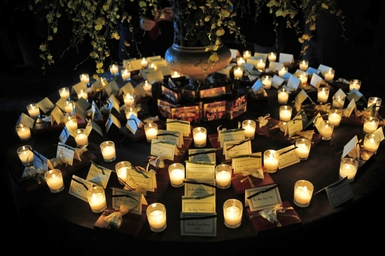 Candlelit escort card table at opulent Chicago wedding reception