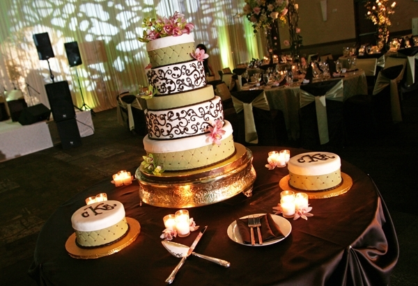 Chic wedding cake with chocolate brown scroll pattern and monogram details