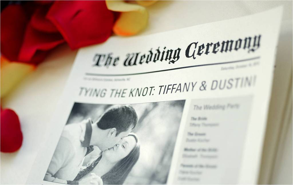 Bride-and-groom-announce-wedding-in-local-north-carolina-newspaper-fall-rose-petals-scattered-around.full