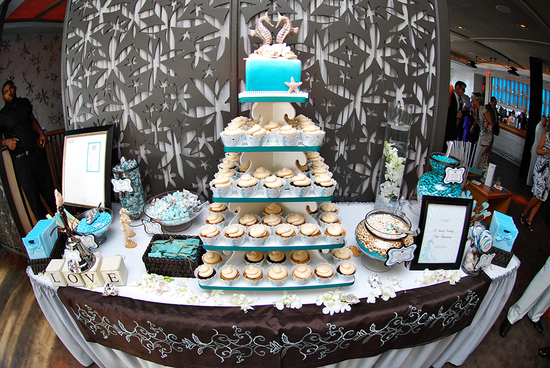 Long Branch wedding reception- beach-themed dessert table with cupcake tree and candy bar