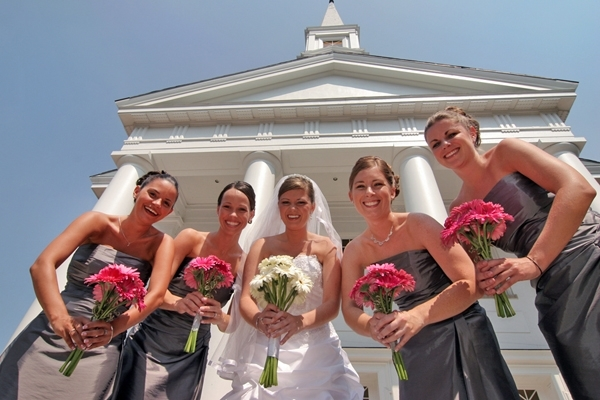 Bride-white-wedding-dress-bridesmaids-grey-strapless-dresses-hold-bouquets.full