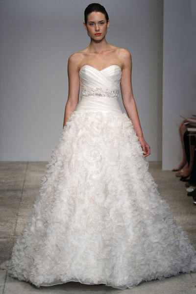 Full a-line wedding dress by Kenneth Pool featuring jeweled bridal belt and sweetheart neckline
