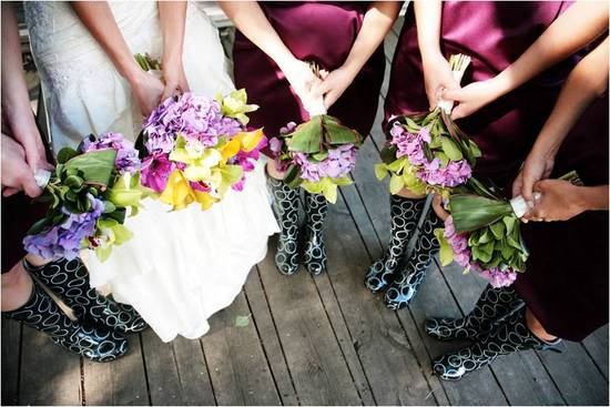 Bride and bridesmaids show off vibrant fresh flower bouquets