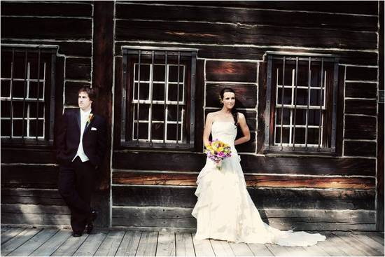 Classic bride and groom in ivory strapless wedding dress & black tux, pose in this artistic wedding