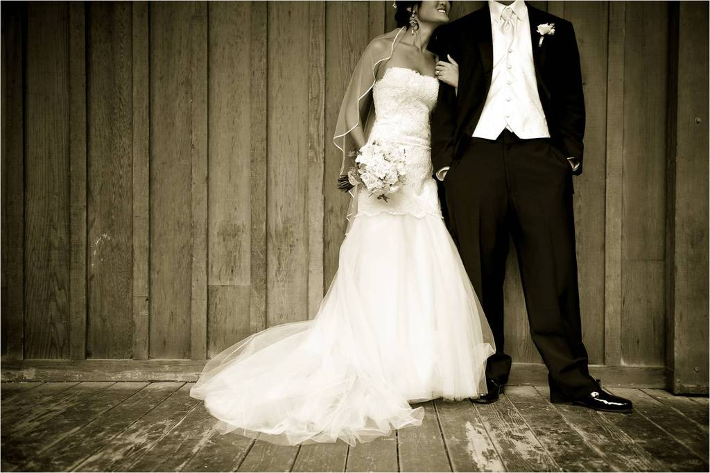 Beautiful bride and groom pose in full wedding day attire for Wedding dresses for outdoor country wedding