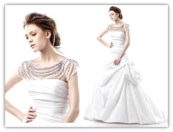 White strapless wedding dress with pick up skirt and illusion neckline