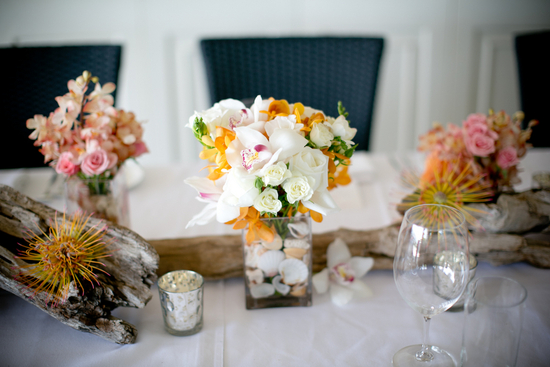 Colorful Flowers Driftwood and Seashell Centerpieces