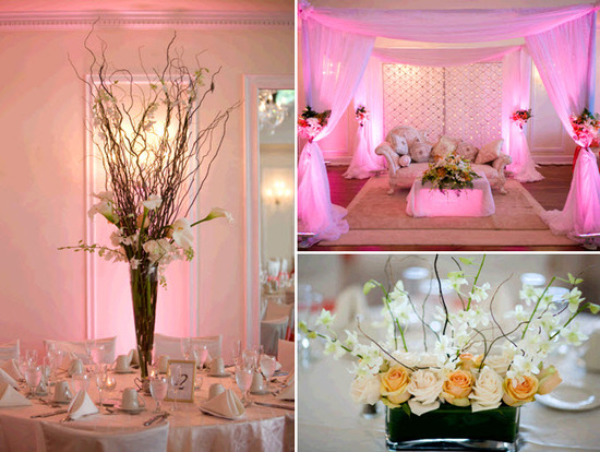 Pastel yellow, pink, peach wedding reception decor, lit up with pink lights