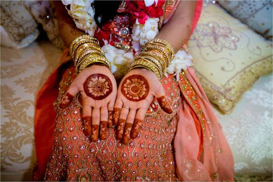 Stunning Indian bride shows off wedding day henna on hands