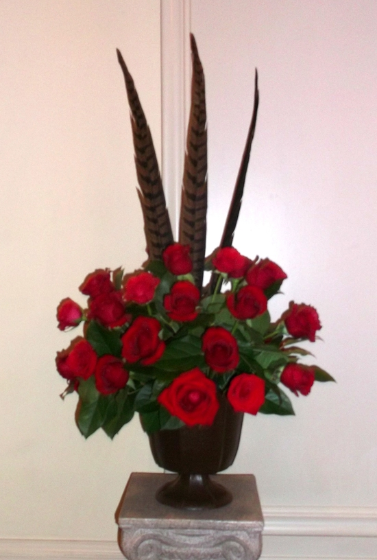 Phesant feather and rose arrangement