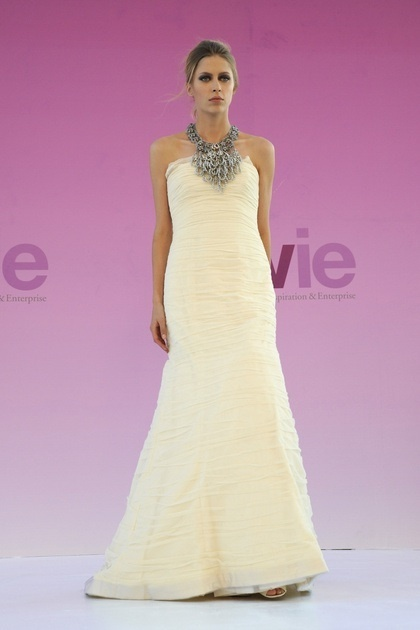 This strapless Vera Wang dress is styled with a statement silver neckpiece and rouching.