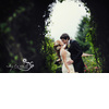 Bride-groom-vintage-wedding-kiss-outside-amidst-garden-of-wedding-venue.square