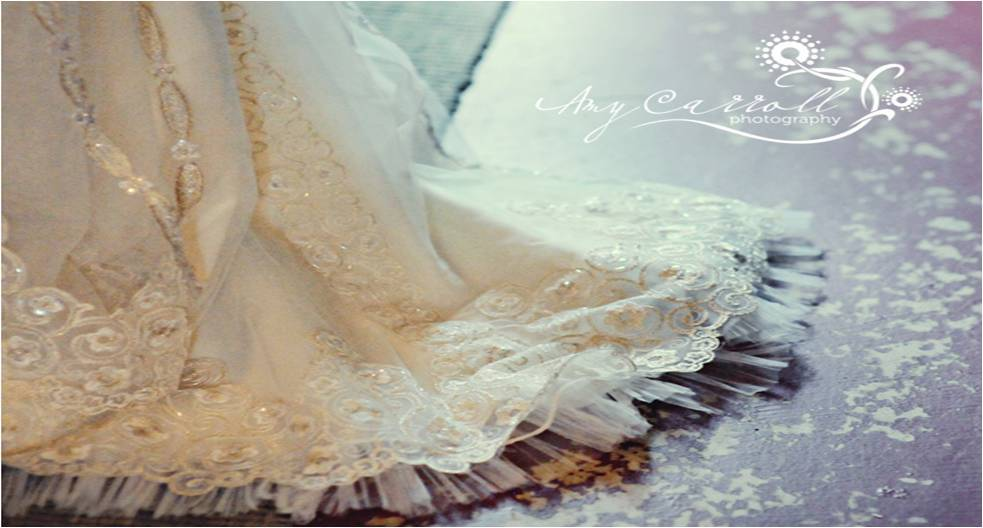 Vintage-inspired ivory lace wedding dress with tulle skirt