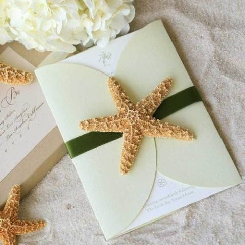 This starfish themed wedding invitation with green accents is perfect for a beach wedding.
