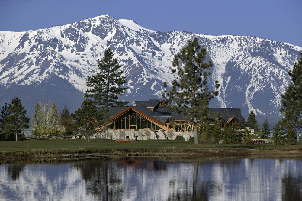 Rustic Wedding Venue In Lake Tahoe With Snow Covered Mountains In Back