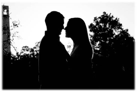 Artistic engagement session photo- black and white silhouettes of bride and groom