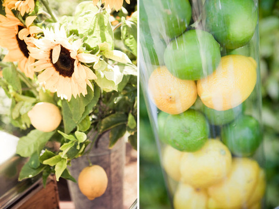 Bright sunflowers in rustic vases, and lemons & limes in clear hurricane vases, for table centerpiec