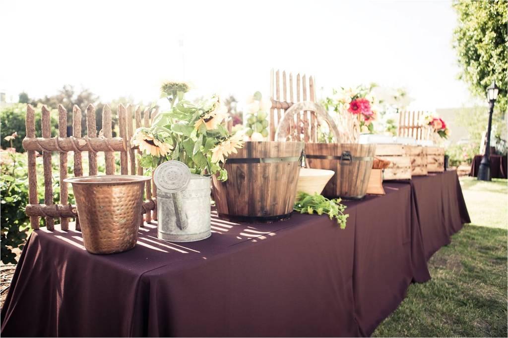 Outdoor-california-wedding-rustic-anthropology-vibe-wood-bushel-baskets-antique-silver-pitchers-wedding-reception-escort-table.full