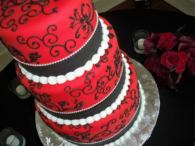 This Three Tier Red And Black Wedding Cake Has White Piping.