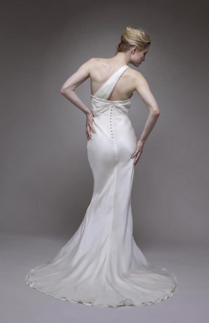 Romantic-wedding-dress-spring-2011-ivory-satin-mermaid-silhouette-covered-buttons.full