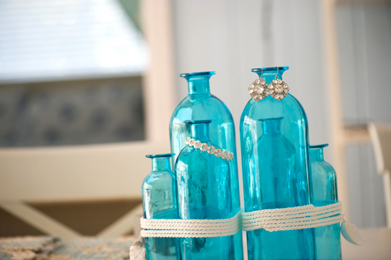Gorgeous Jewelry Hanging on Blue Bottles