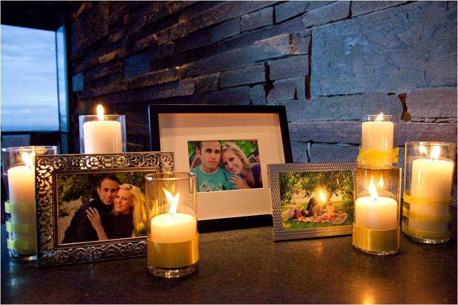 Personal-touches-at-arizona-wedding-in-july-framed-photos-of-bride-groom-romantic-pillar-candles.full