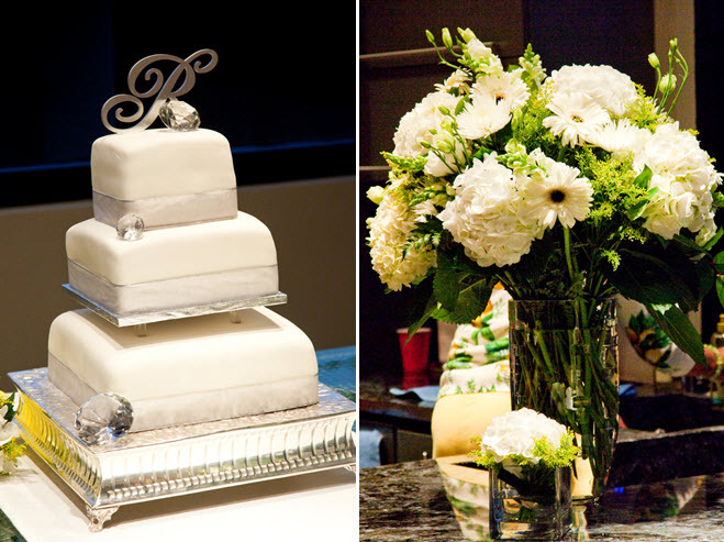 White fondant three tier wedding cake with silver monogram cake topper; high ivory and green floral