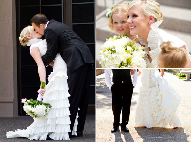 Groom in black tux dips his beautiful bride after saying I Do