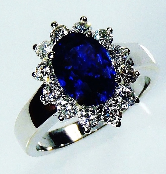 Untreated natural oval cut sapphire and diamond ring