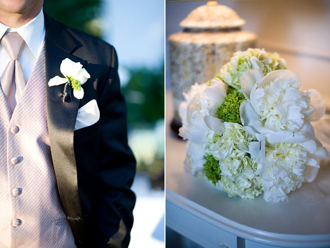 Groom dons light mauve tux vest and tie, black formal tux; white and green bridal bouquet
