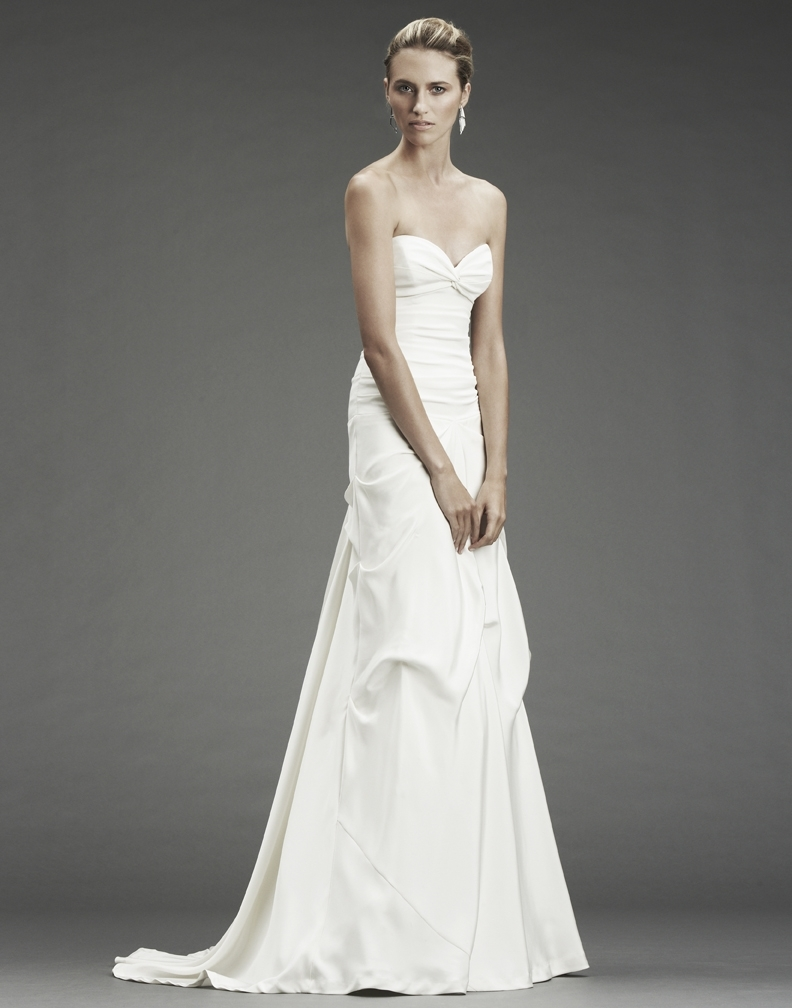Chic and simple a-line white wedding dress with sweetheart neckline from Nicole Miller