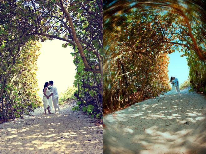 Destination-wedding-bride-and-groom-kiss-on-beach-under-trees.full