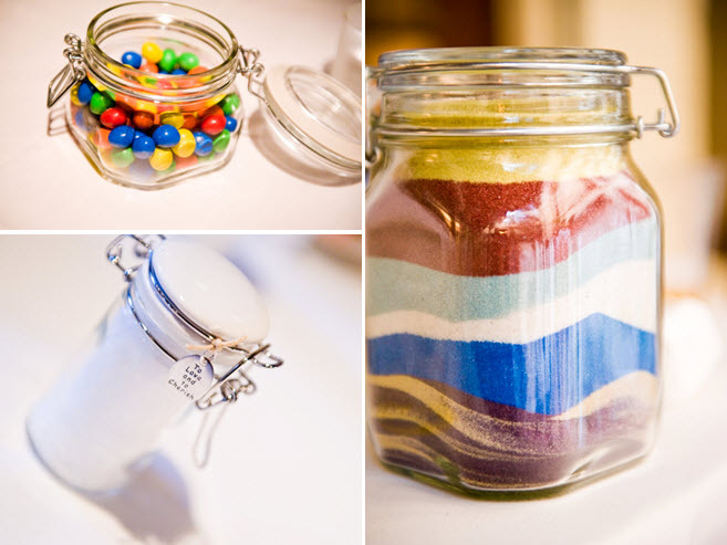 Clear jars filled with colorful unity sand, colorful candy, and wedding day words and advice