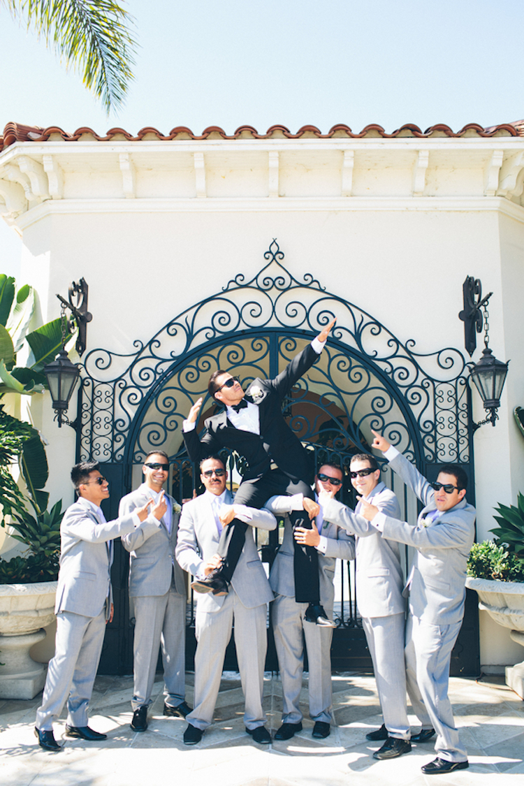 Groomsmen_lifting_groom._.full