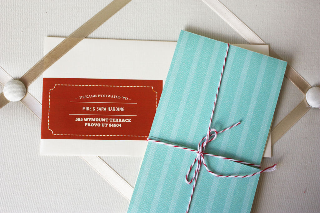 This whimsical wedding inivitation uses an unusual color scheme of turquoise and maroon