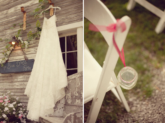 Bride's ivory lace wedding dress hangs outside; ceremony chairs decorated with mason jars and pink r