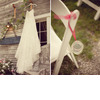 Country-michigan-outdoor-rustic-wedding-ivory-lace-wedding-dress-hangs-on-barn-white-ceremony-chairs-with-red-ribbon.square