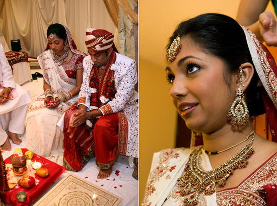 Bride and groom, wearing traditional dark red and gold Indian wedding day attire, pray during weddin