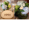 Stylish-blooms-fresh-natural-wedding-flowers-reception-centerpieces-carved-wood-table-numbers-blue-hydrangeas-light-blue-green-ivory.square